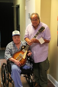 HANDOUT PHOTO:   Harry Ryan (left) and Gil Southworth, Jr., with the 1960 Gibson Les Paul Sunburst guitar that Gil had just bought at auction at Quinn's Auction Galleries in Falls Church, Va., on Sept. 13, 2014. Harry is the guitar's original owner. It went for $140,000.   (Courtesy of Quinn's Auction Galleries)